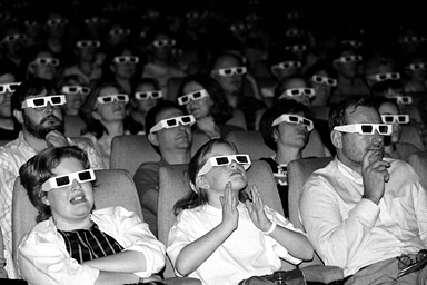an_audience_watches_a_film_through_3d_glasses