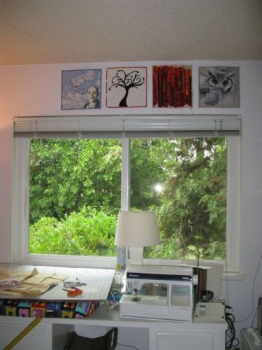 Four-In-Art quilts hung up