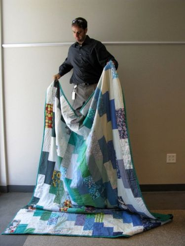 CCA holding quilts