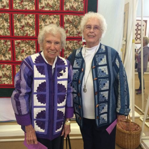 Twin Ladies in Quilted Jackets