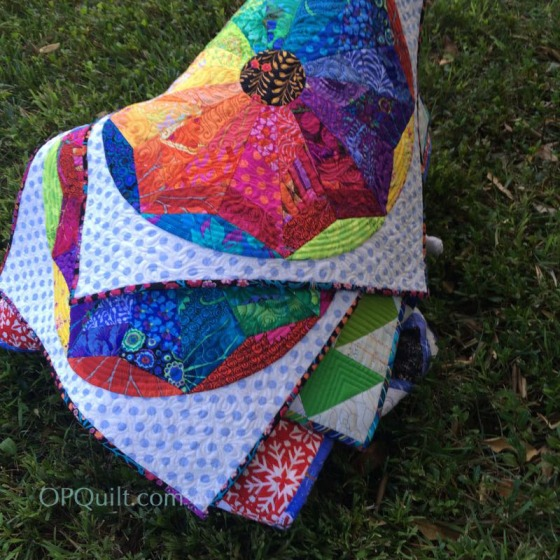 Stack of colorful quilts