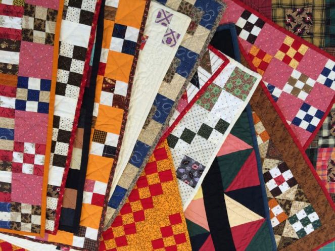 Gwen_stack of quilts