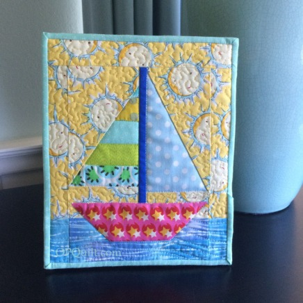 Tiny Sailboat Quilt_front on frame